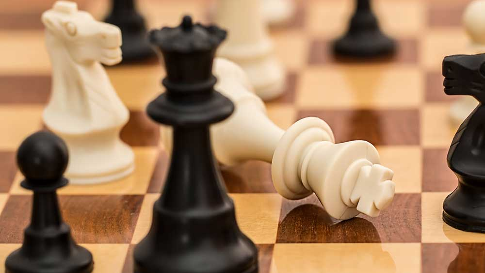 Checkerboard with checkmated white king