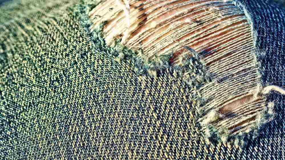 Closeup of torn jeans
