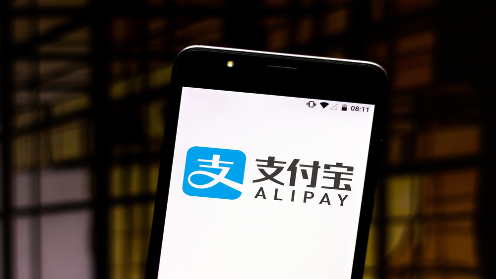 Phone with Alipay app open