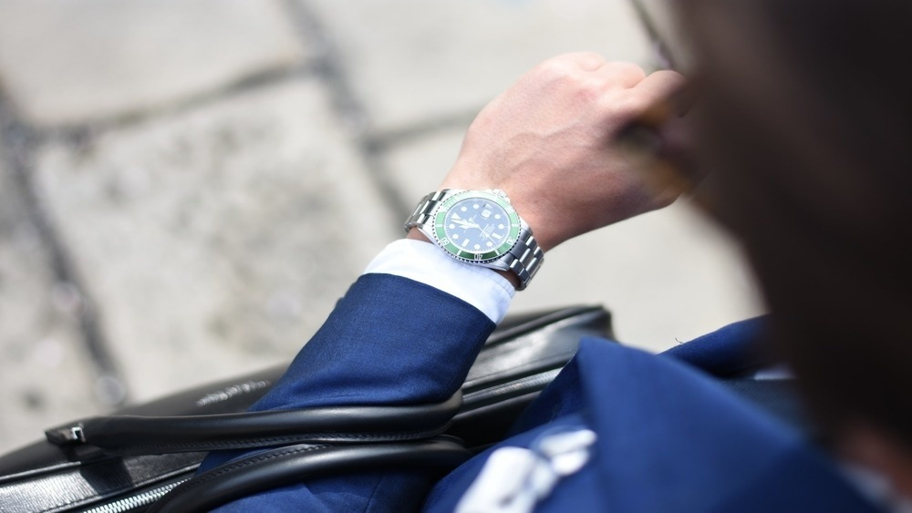 Businessman looking down at his wrist watch