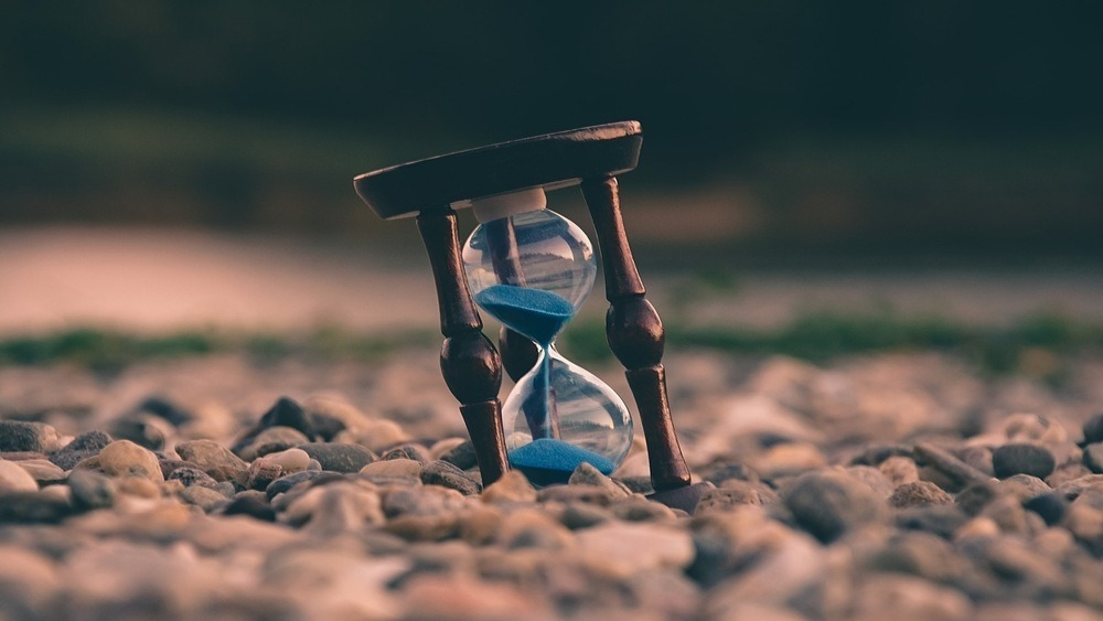 Picture of hourglass on pebble shore